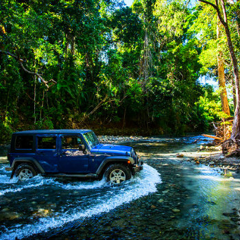 4WD crossing the river near Cape Tribulation Daintree
