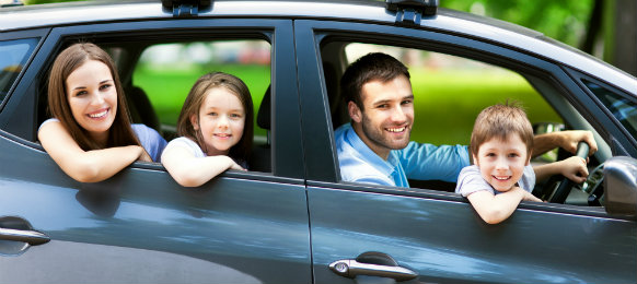 happy family inside their car