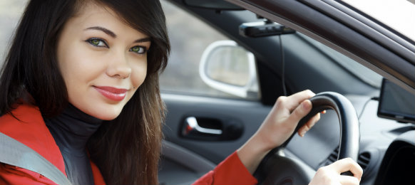 female executive thrilled to drive her rental car