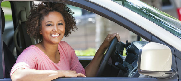 smiling woman excited for her road trip