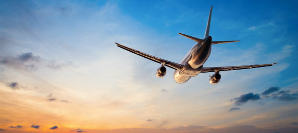airplane flying in sunset