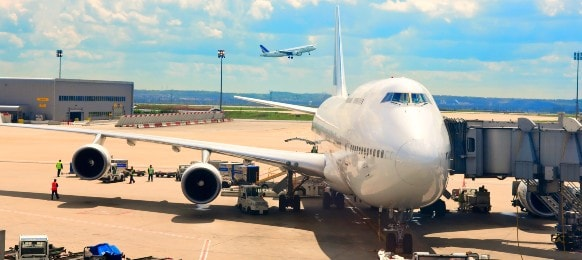 airplane near the terminal of an airport
