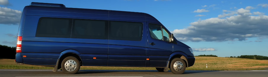 blue minibus on the highway during daytime