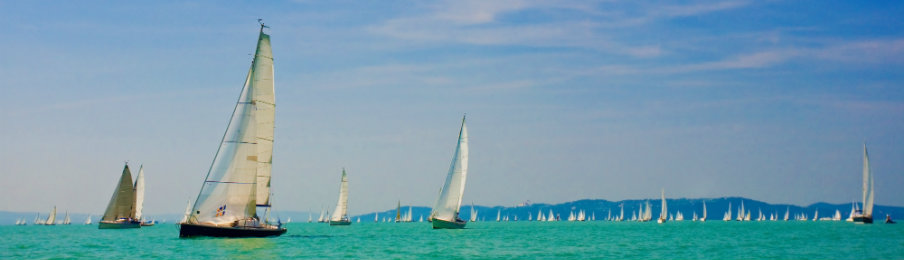 Boats sailing in the sea for Queensland's Season of Sailing event