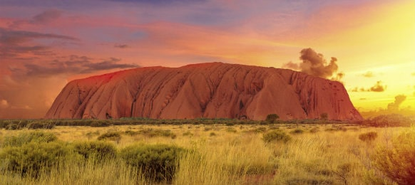 colourful clouds in ayers rock at sunset