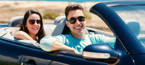 couple in a road trip using a convertible car