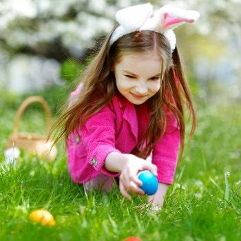 cute little girl hunting easter eggs