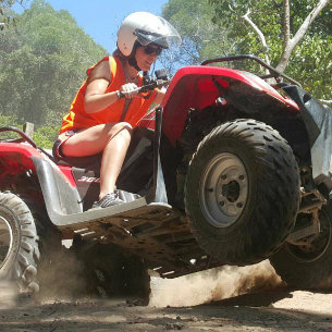 woman enjoying her quad bike adventure via Nooasa Quad Bike Tours