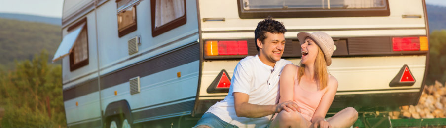 happy couple near their campervan