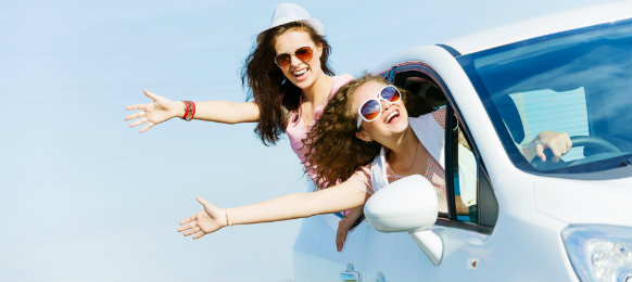 group of young ladies riding a white car hire