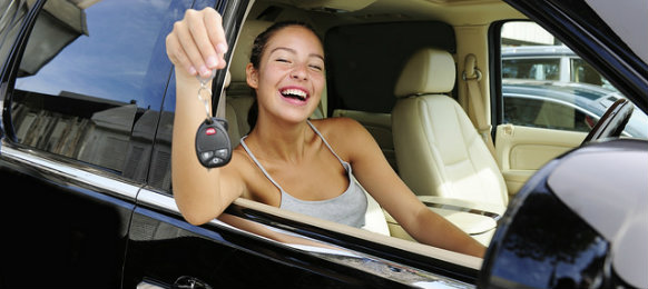 happy woman showing off car key