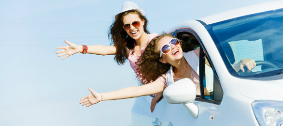 happy women in the car hire