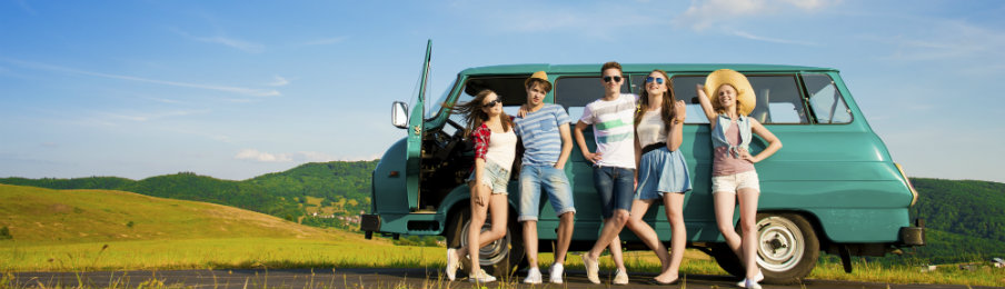 hipster friends in front of their campervan hire