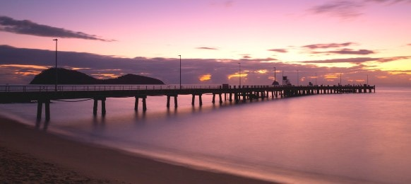 the iconic palm cove and jetty boat ramp at sunrise