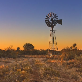 lovely sunset in kalahari with windmill