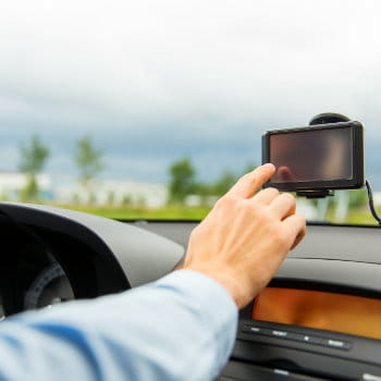 Man tapping the GPS navigator while driving