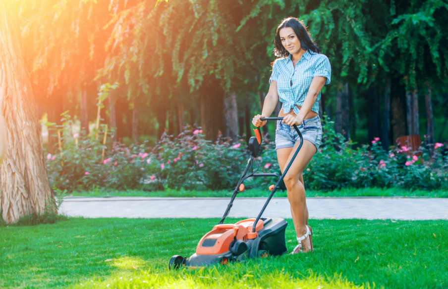woman mowing the lawn