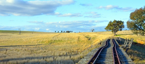 old rusty railway track over boorowa river, nsw