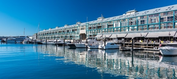 picturesque woolloomooloo wharf with white yachts and boats