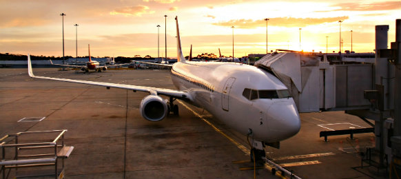 plane at melbourne airport teminal at sunrise