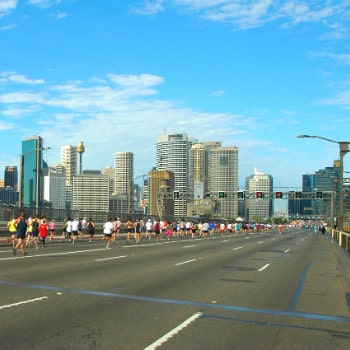 runners passing at the harbour bridge in sydney