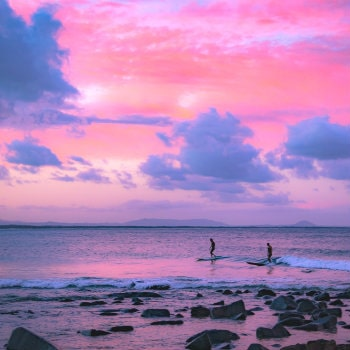 surfers riding waves in queensland