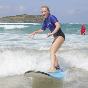woman enjoying surfing at Australian Surfing Adventures