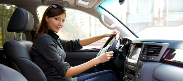 successful woman driving a car hire